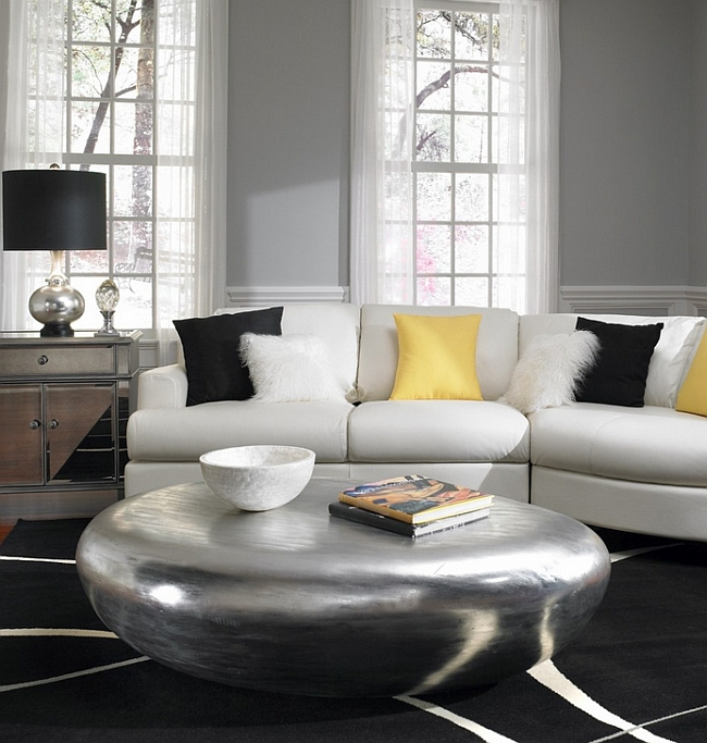 Amazing coffee table and black decor accentuate the gray and yellow touches in the room