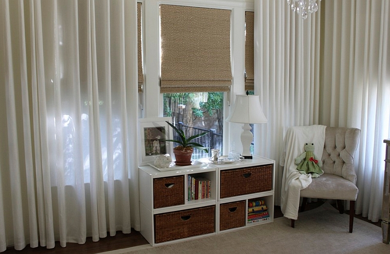 Beautiful Roman shades coupled with some lovely sheer curtains