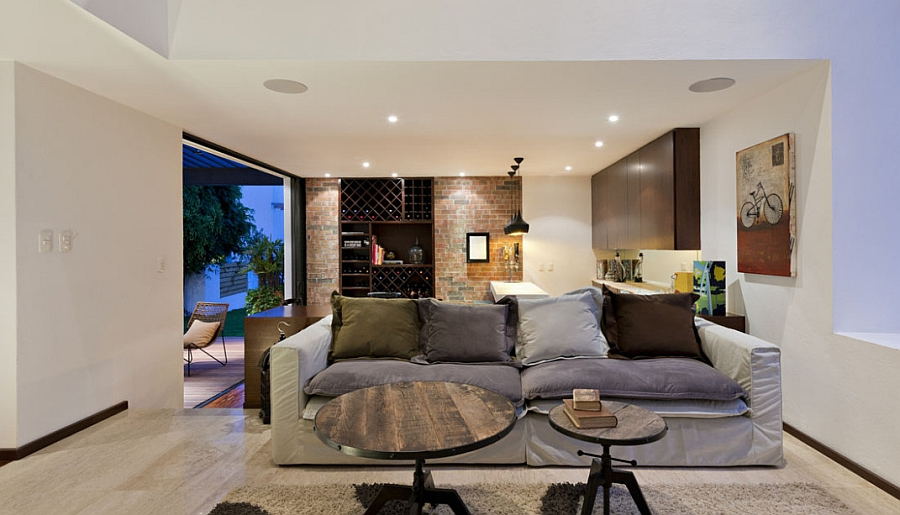 Beautiful brick wall adds visual contrast in the living space Trendy Home Extension In Mexico Dazzles With Inviting Social Spaces