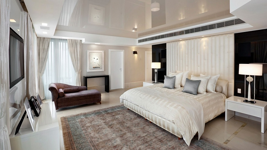 Beautiful contemporary bedroom in black and white with a headboard that extends up to the ceiling