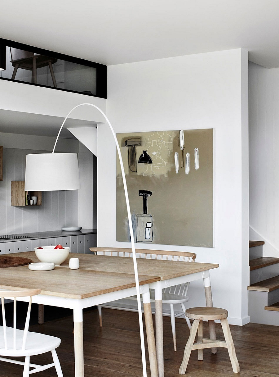 Beautiful floor lamp inspired by the Arco enlivens the dining area