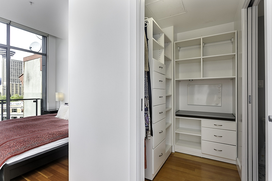 Bedroom with a walk-in closet next to it in the compact apartment