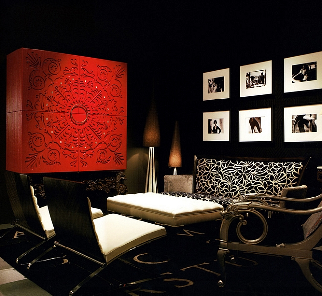 Black and red used in a dramatic and bold fashion in the living room