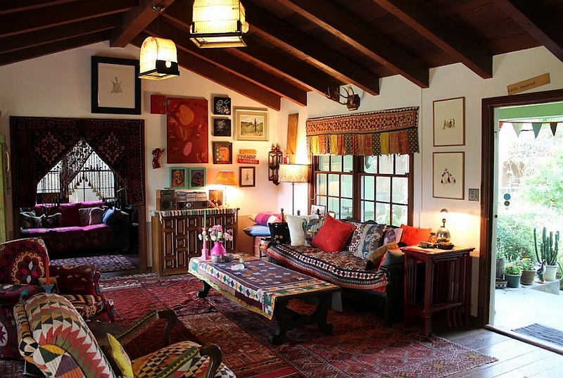 Bohemian living room clad in a wide variety of hues and overlapping rugs