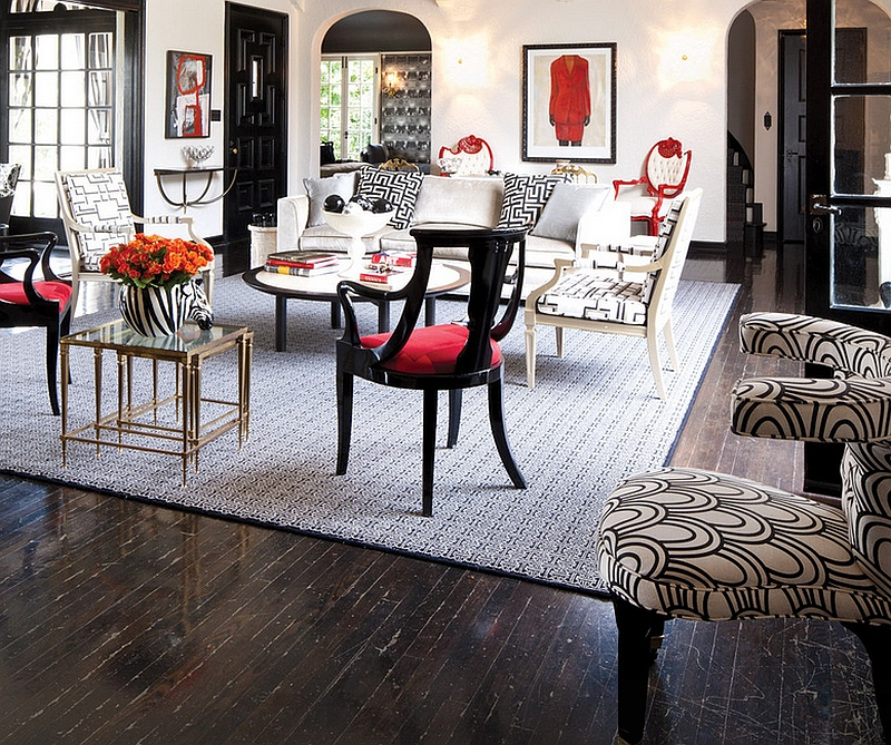 Bold black and red used in a whimsical fashion in the living room along with white