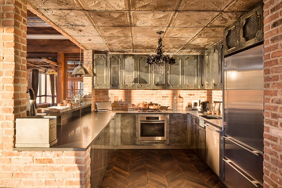 Chevron floors, exposed brick walls and vintage cabinets in the kitchen