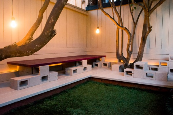 Cinder block lounge area with lighting