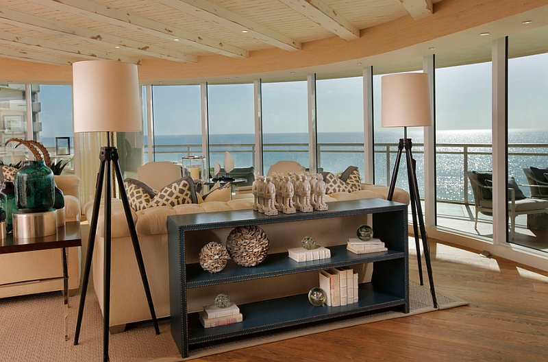 Coastal themed living room with tall tripod floor lamps