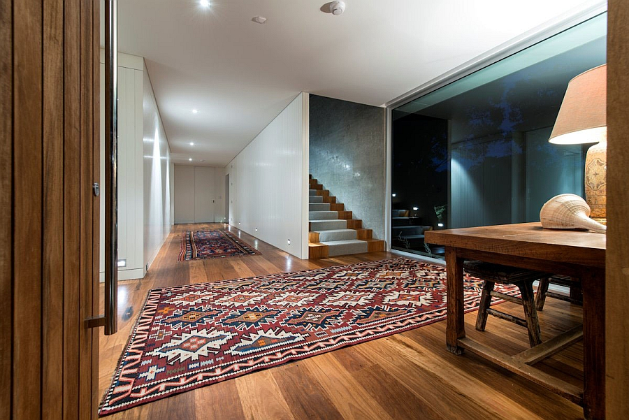 Colorful area rugs enliven the entry