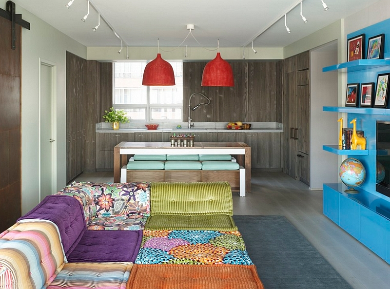Colorful family room with a cool Bohemian style welcomes you with plush seating!