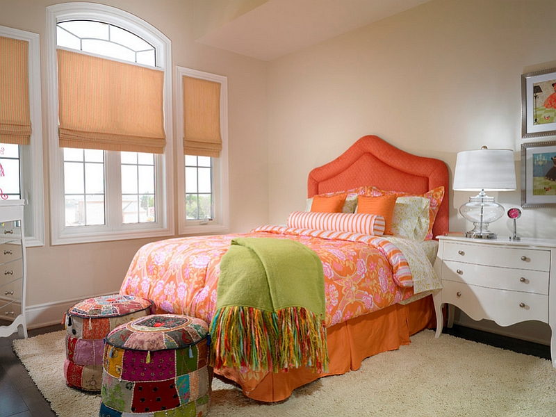 Colorful ottomans at the end of the bed give the room a Bohemian touch