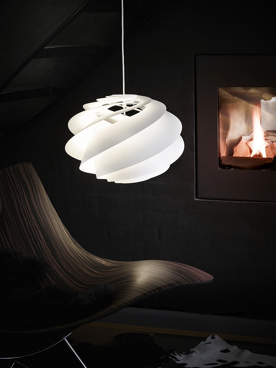 Combine the Swirl pendant with the right seating to create an inimitable redaing nook