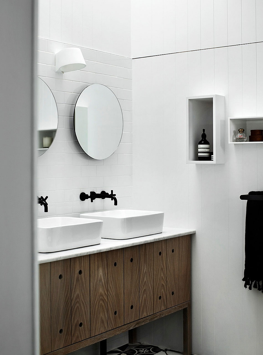 Compact bathroom vanity in wood with stone top and twin sinks