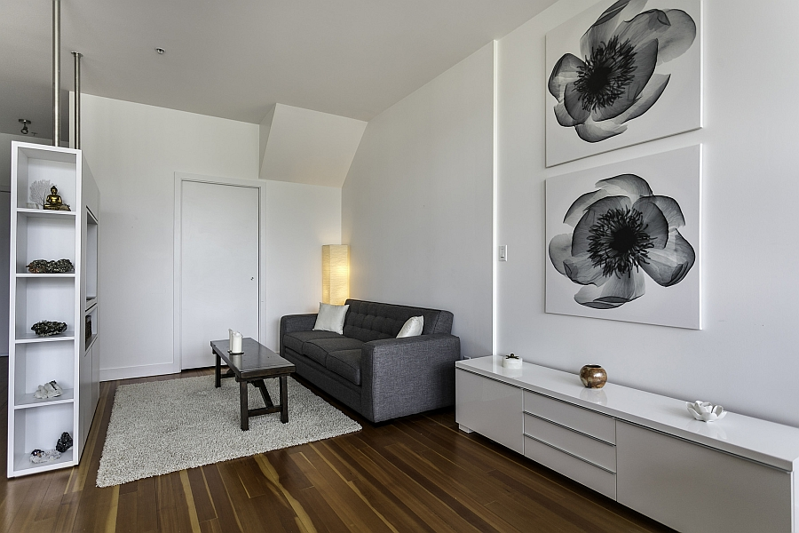 Compact living space in white with wall-mounted entertainment unit