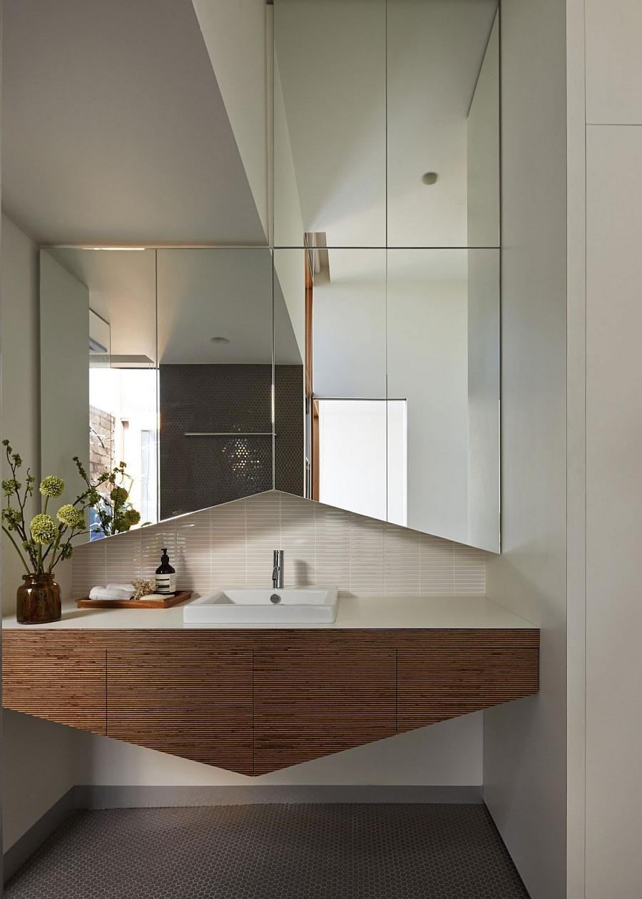 Contemporary bathw ith penny tile backsplash and flooring