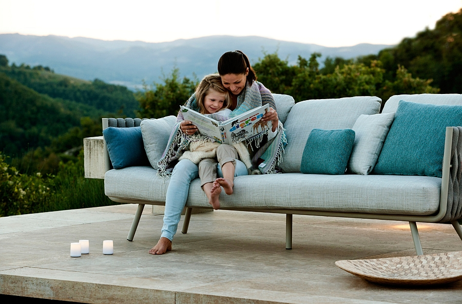 Contemporary outdoor sofa with plush cushions and trendy silhouette