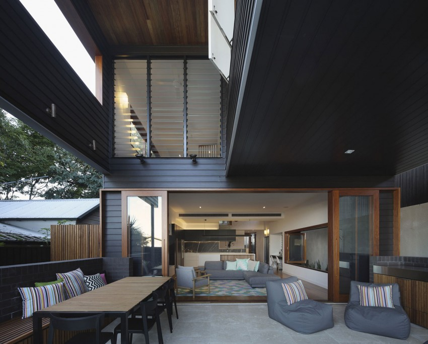 Cool outdoor lounge gets ample shade thanks to the upper level of the house