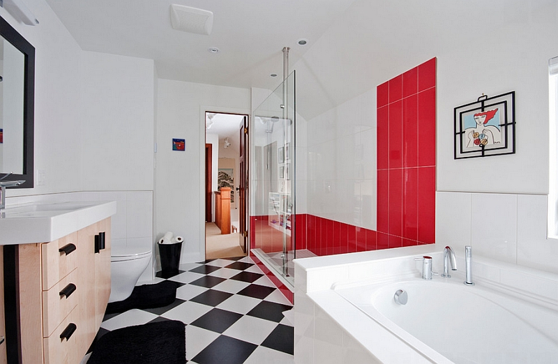 Custom glass shower with bold red tiles stands out visually
