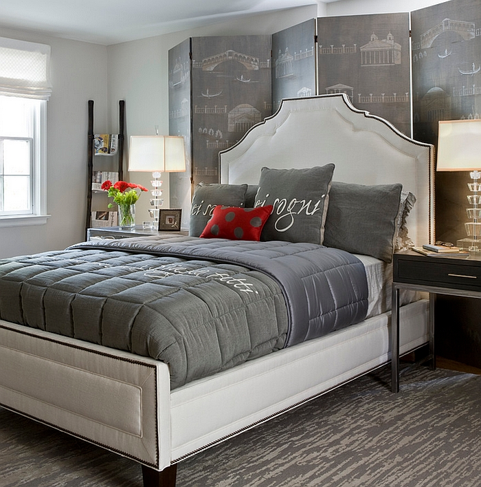Custom hand-painted screen and multiple shades of grey shape this exceptional bedroom