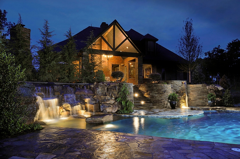 Elaborate swimming pool with multi-level waterfalls and patios