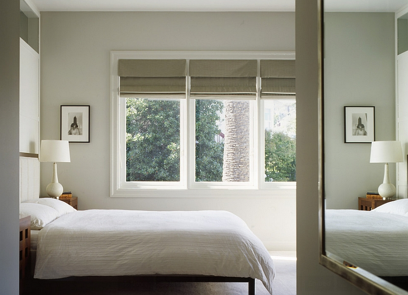 Enhance the color scheme of the room with the right roman shades