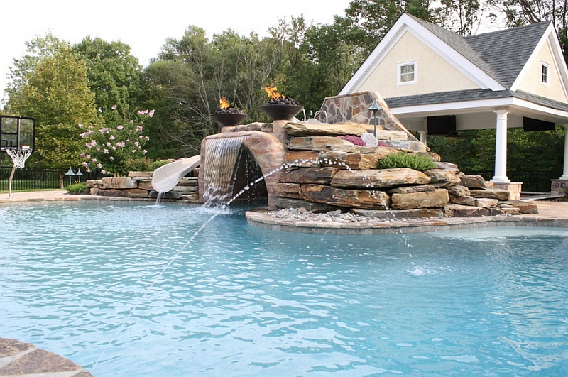 Expansive pool with a water slide, waterfall feature and water jets!