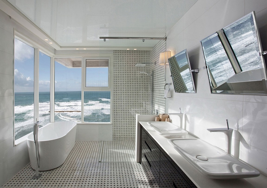 Exquisite contemporary bath in white that seems to be hovering above the ocean!