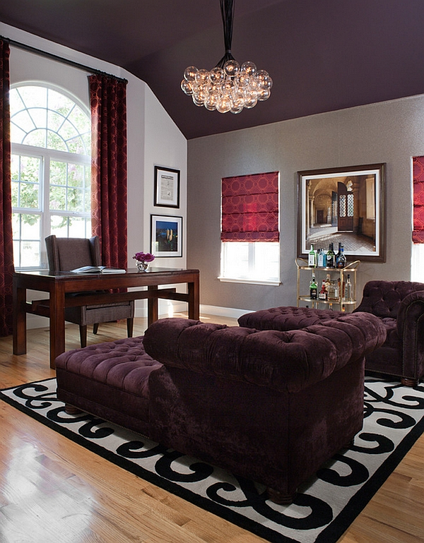 Exquisite home office with red drapes and roman shades