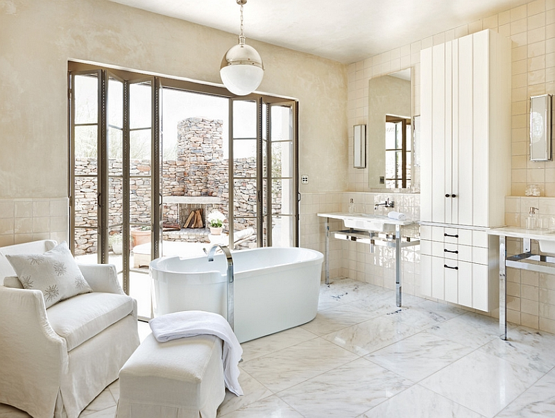 Exquisite modern bathroom with a large Hicks Pendant above the standalone tub