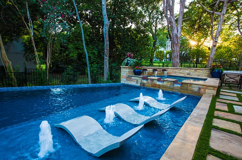 Exquisite pool area with lovely little fountains and water loungers