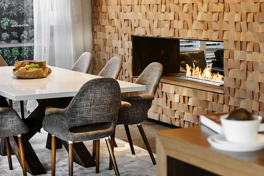 Exquisite textured wall steals the show in this dining room