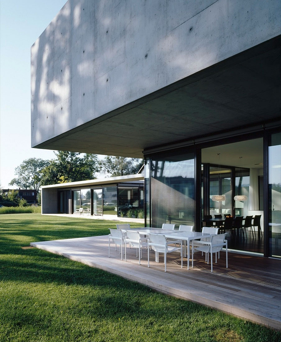 Exterior is a blend of raw concrete, wood and glass