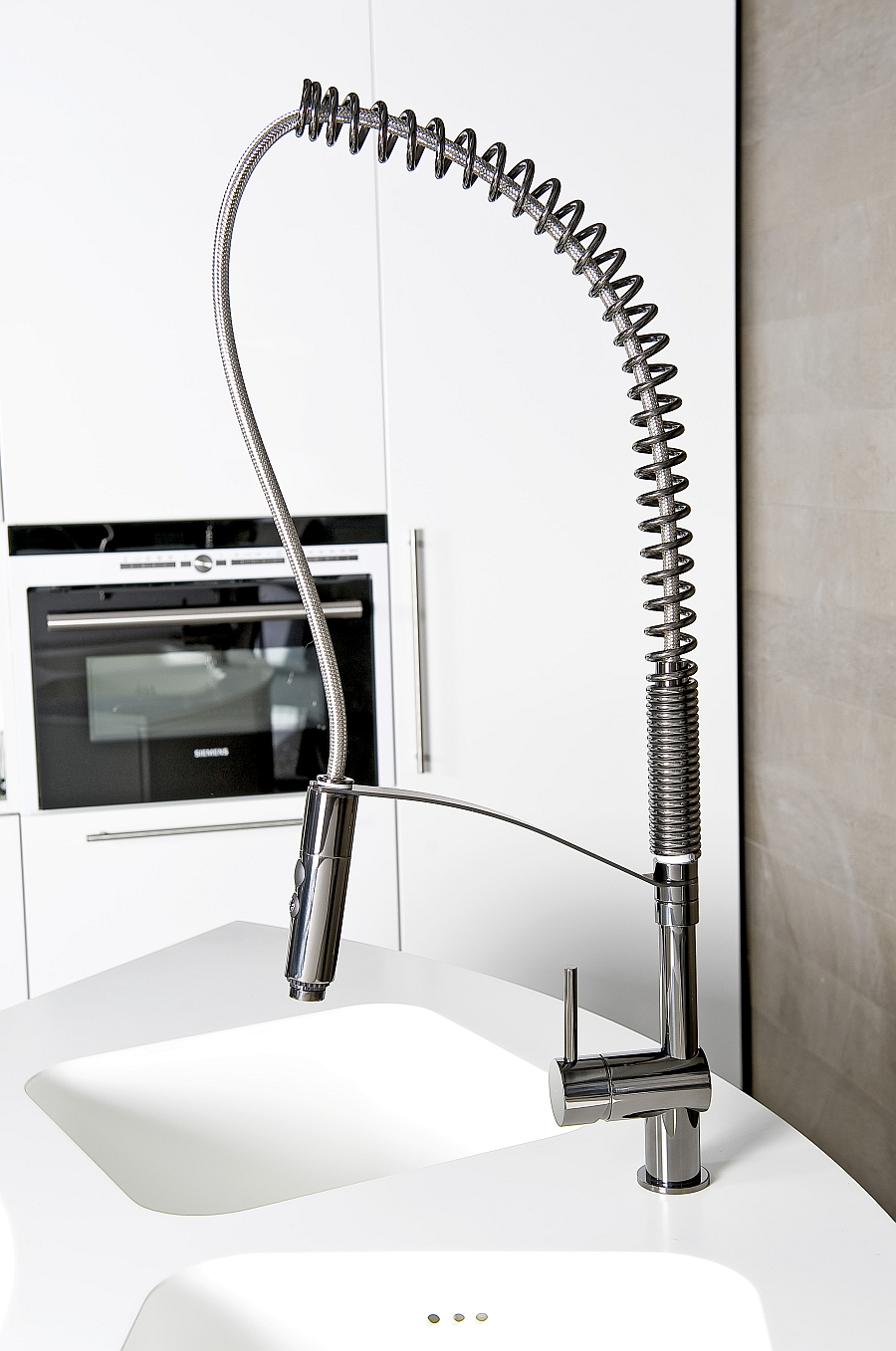 Fabulous kitchen faucet is available in three different finishes