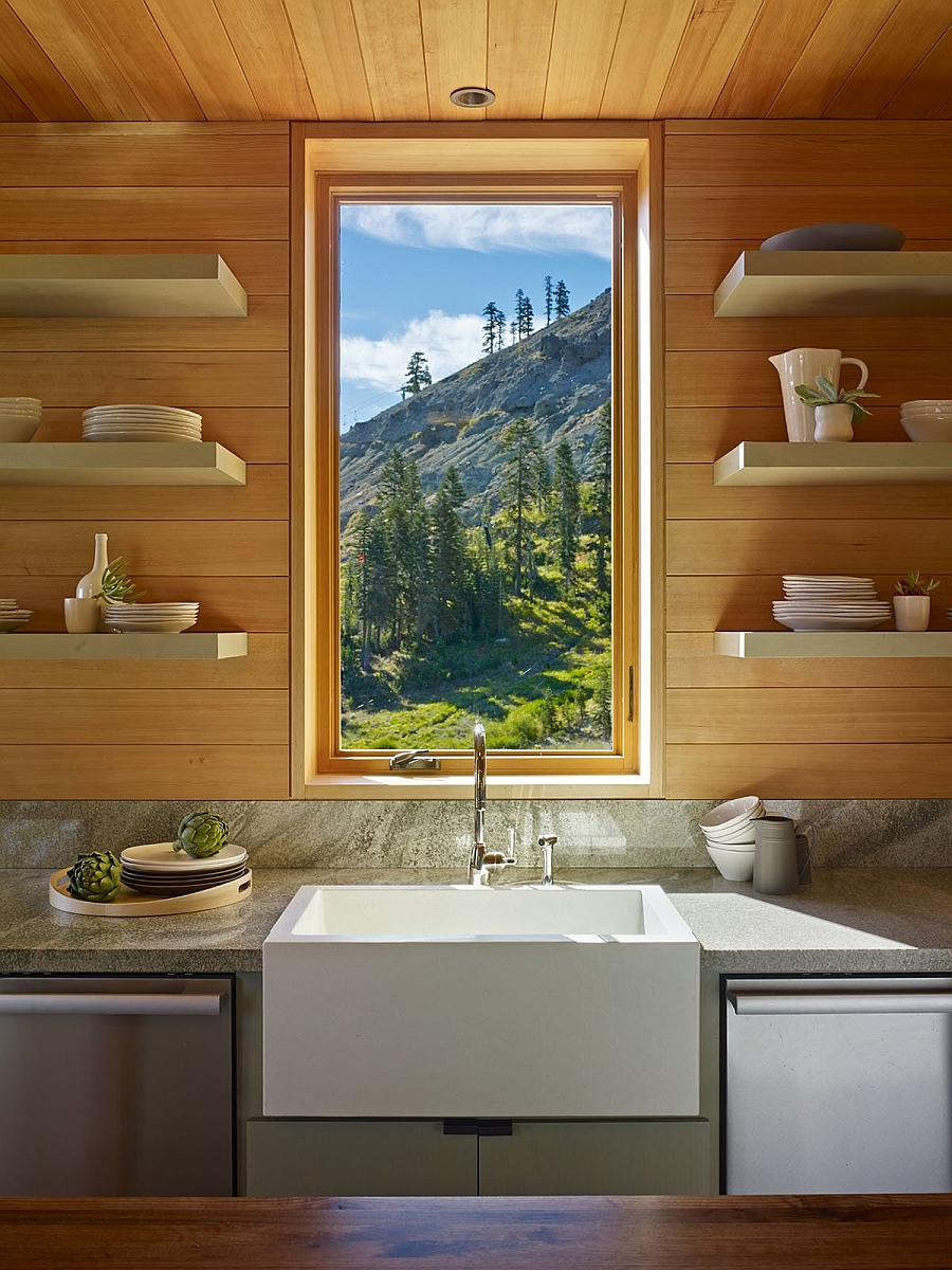 Framed views of the mountain slope outside from the elegant kitchen