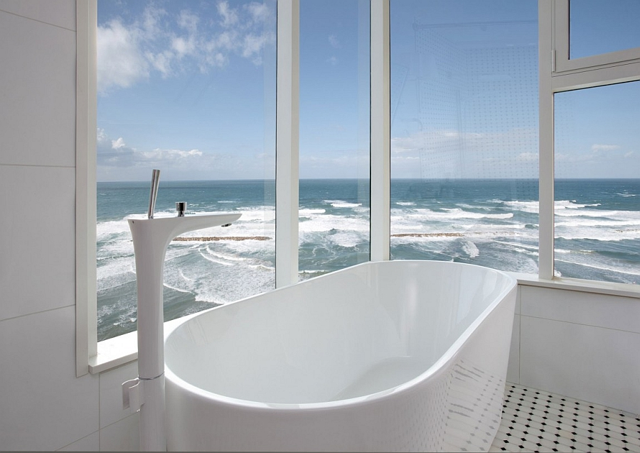 Freestanding tub in the contemporary bath that seems to stand on the edge of the ocean
