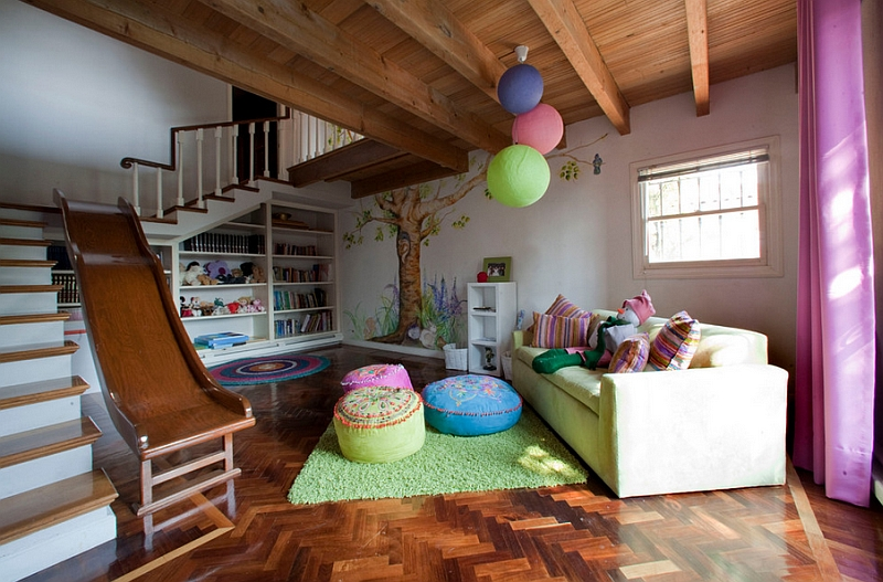Give the kids' basement playroom a fun slide entrance