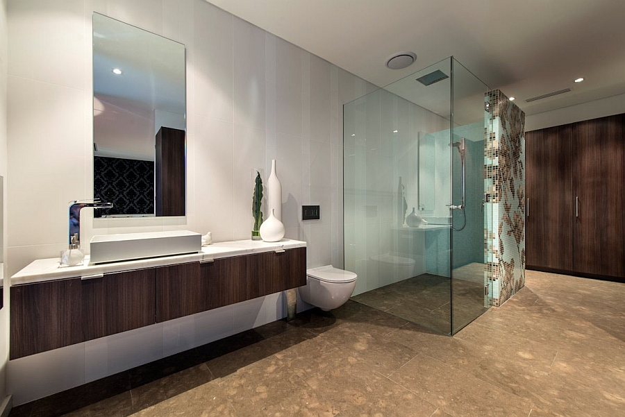 Glass shower area lends visual lightness to the bathroom