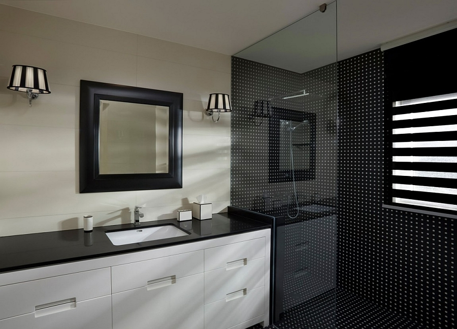 Glass shower area with black tiles is a rarity in modern homes