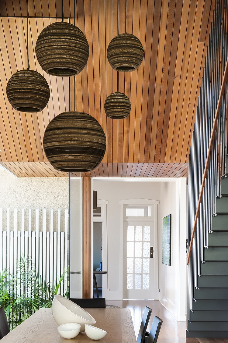Chic sydney house extends its living area with a cool for Pendant lighting for high ceilings