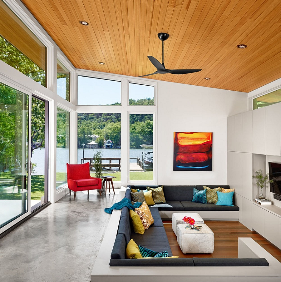 Gorgeous sunken living area and sliding glass walls create a breezy interior Charming Ski Shores Lakehouse In Texas Offers A Tranquil Weekend Escape