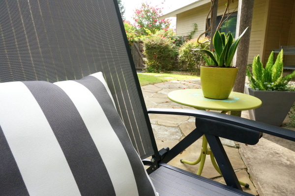Gray and white striped pillow on a modern lounger