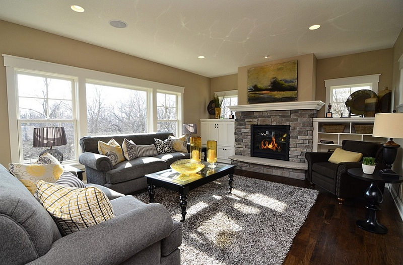 Gray and yellow color palette lends sophistication to this contemporary living room with a fireplace