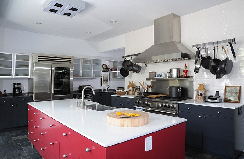 Kitchen with white countertops, black shelves and a red kitchen island