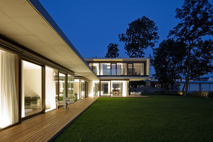 Large and sleek wooden deck allows you to enjoy the outdoors in an undisturbed fashion