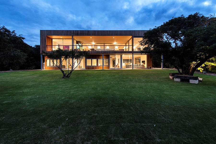 Large glass doors and windows connect the interior with the backyard