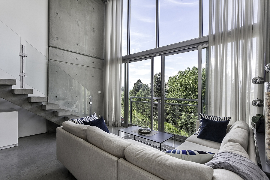Large glass sliding doors offer unabated city views