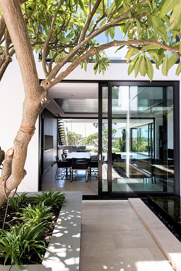 Large sliding glass doors connecting the dining area with the backyard