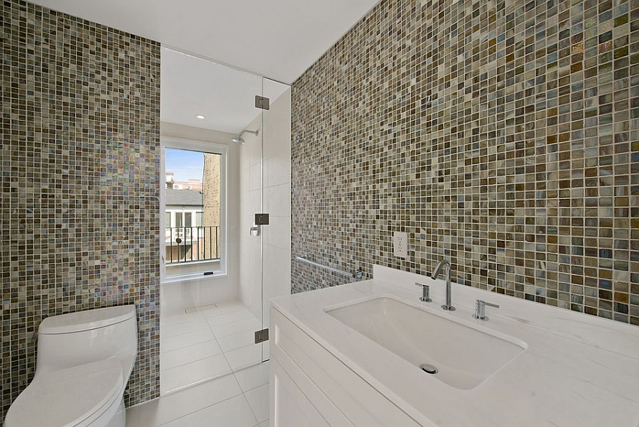 Lavish bath with a glass shower area and colorful tiles