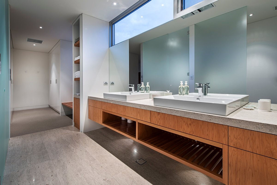 Lavish bathroom with a floating vanity featuring two sinks