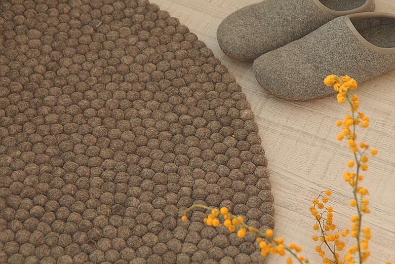 Lovely Felt Ball Rug in warm earthen tones